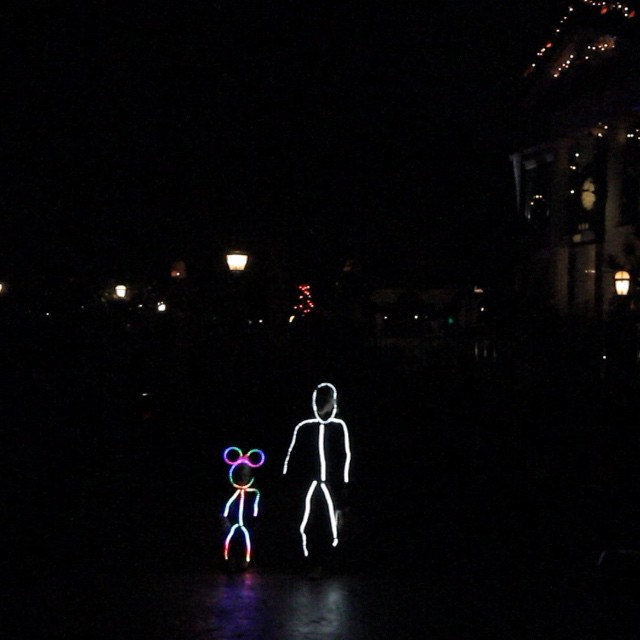 The new Disney themed Minnie Mouse LED costume (left) and the old LED stick figure costume from 2013 (right) showcased by an adult. & Stick Figure LED Minnie Mouse Costume - LEDinside