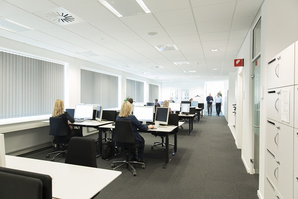 Downlights and louvre luminaires in the offices and conference rooms provide pleasant vdu compliant lighting image osram