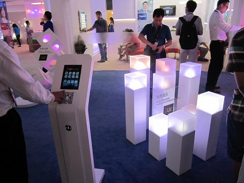 A visitor uses the touch panel to change the lighting function of the hue bulbs at the Philips Lighting booth. & Smart Lighting Takes Center Stage Again at GILE 2014 - LEDinside azcodes.com