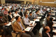 The crowd listens attentively to the keynote addresses.